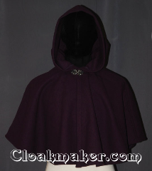Cloak:3457, Cloak Style:Shaped Shoulder Ruana Cloak, Cloak Color:Plum Purple, Fiber / Weave:Wool Blend, Cloak Clasp:Vale, Hood Lining:Unlined, Back Length:20&quot; back<br>18&quot; side, Neck Length:17&quot;, Seasons:Southern Winter, Fall, Spring, Note:The perfect starter cloak for a<br>child / young adult.<br>Bright and colorful plum<br>wool blend melton sized for<br>play and walking.<br>Spot or Dry clean only..
