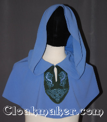 Cloak:3470, Cloak Style:Unique pullover capelet<br>with lirepipe hood / embroidery, Cloak Color:Periwinkle Blue, Fiber / Weave:Wool Blend Suiting cotton panel, Cloak Clasp:Hidden Hook & Eye clasp<br>keyhole neck with embroidery, Hood Lining:Unlined<br>with 43&quot; lirapipe, Back Length:13.5&quot;, Neck Length:20&quot;, Seasons:Fall, Spring, Summer, Note:A unique piece with a medieval flair<br>this periwinkle blue pullover has a<br>hunter green celtic horse and knot<br>embroidered panel with a keyhole neck<br>and hidden hook and eye clasp.<br>The  43&quot; Lirepipe hood<br>is useful as storage or a scarf on<br>windy days.<br>Handwash lay flat to dry..