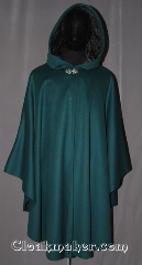 Cloak:3482, Cloak Style:Shape Shoulder Ruana, Cloak Color:Forest Green, Fiber / Weave:70% wool, 20% cashmere,<br>10% nylon blend, Cloak Clasp:Vale, Hood Lining:Black Crushed Velvet, Back Length:43.5&quot; back 27.5&quot; side, Neck Length:21&quot;, Seasons:Southern Winter, Fall, Spring, Winter, Note:A woodland fairy tale piece<br>this classic shape shoulder ruana<br>is made of a wool blend<br>with a full-sized hood lined in a<br>black crushed velvet and<br>accented with a classic pewter vale<br>hook-and-eye clasp.<br>A cross between a cape and a cloak,<br>a ruana is a great way to keep warm<br>while frequent, unhindered use of<br>your arms is needed.<br>With an overarm of 27.5&quot; this cloak<br>has less bulk than a<br>traditional Ruana and<br>makes a great driving cloak!<br>Spot or dry clean only<br>Can be hemmed to height..