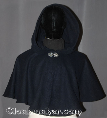 Cloak:3491, Cloak Style:Full Circle Cloak Short, Cloak Color:Navy Blue, Fiber / Weave:Wool Blend, Cloak Clasp:Vale, Hood Lining:Unlined, Back Length:19.5&quot;, Neck Length:20&quot;, Seasons:Winter, Southern Winter, Fall, Spring, Note:This navy blue short full circle cloak<br>will keep you warm on chilly winter nights.<br>Perfect for a child to grow with or<br>a warm shrug for a night on the town.<br>The silver-tone Vale clasp is the final touch<br>on this functional and elegant cloak.<br>Spot or dry clean only..