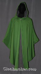 Cloak:3492, Cloak Style:Shape shoulder Ruana raincoat w/ backpack pleat, Cloak Color:Green, Fiber / Weave:3 layer ultrex, Cloak Clasp:Vale, Hood Lining:Unlined grey fleece interior<br>double sided fabric, Back Length:44&quot;back<br>27&quot; overarm, Neck Length:22.5&quot;, Seasons:Winter, Southern Winter, Fall, Spring, Note:You will be singing in the rain on your way<br>to school or hiking in this waterproof<br>ultrex ruana with a added room for a backpack.<br>The 3 layered fabric has a<br>green crosshatched outer lining<br> and an absorbent grey fleece interior,<br>with a thin windblocking material in between.<br>The added pleat in back allows for you<br>and your supplies to travel underneath<br>your cloak&#039;s protection with little<br> carefice to your comfort.<br>A cross between a cape and a cloak,<br>a ruana is a great way to keep warm<br>when frequent, unhindered use of<br> your arms is needed.<br>Ruanas make great driving cloaks!<br>Machine wash cold..