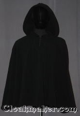Cloak:3528, Cloak Style:Shape Shoulder<br>Pullover, Cloak Color:Black, Fiber / Weave:Windpro Fleece, Cloak Clasp:TBD Keyhole, Hood Lining:Unlined matching Shearling interior<br>double sided fabric, Back Length:29&quot;, Neck Length:21&quot;, Seasons:Winter, Southern Winter, Fall, Spring, Note:A classic black windpro shape shoulder<br>pullover cloak that will keep you<br>warm and dry on chilly nights.<br>This soft and cuddly cloak has a interior<br>faux shearling texture for extra comfort.<br>The final touch on this functional and<br>elegant cloak is a water resistant outer<br>layer to keep you dry during light rain/snow.<br>A ideal starter cloak for a child or adult.<br>Machine washable.