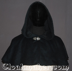 Cloak:3534, Cloak Style:Shape shoulder short capelet, Cloak Color:Navy Blue Heathered<br>with cobalt and green, Fiber / Weave:100% Wool Melton, Cloak Clasp:Vale, Hood Lining:Unlined, Back Length:12.75&quot;, Neck Length:23&quot;, Seasons:Southern Winter, Fall, Spring, Note:The pictures do not do this cloak justice.<br>A shape shoulder short capelet,<br>A perfect starter cloak for an adult or child<br>Made from a gorgeous navy blue wool blend<br>heathered with jewel tone blues and greens<br>adorned with a classic vale hook-and-eye clasp.<br>Spot or Dry Clean Only..
