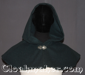 Cloak:3535, Cloak Style:Shape shoulder short capelet, Cloak Color:Forest green, Fiber / Weave:100% Wool Melton, Cloak Clasp:Vale, Hood Lining:Unlined, Back Length:8.75&quot;, Neck Length:21&quot;, Seasons:Winter, Southern Winter, Fall, Spring, Note:Ready to rob the rich?<br>This shape shoulder short capelet is a<br>perfect starter cloak for an adult or child<br>Made from a dark forest green wool blend<br>adorned with a classic vale hook-and-eye clasp.<br>Spot or Dry Clean Only..