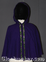 Cloak:3536, Cloak Style:Full Circle Capelet<br>short/youth, Cloak Color:Purple with floral trim, Fiber / Weave:100% Wool, Cloak Clasp:Hidden hook and eye, Hood Lining:Black crushed velvet<br>with floral trim, Back Length:21&quot;, Neck Length:17.5&quot;, Seasons:Fall, Spring, Note:This beautiful child&#039;s cloak is a one of a kind piece<br>Made from discontinued materials this small<br>purple capelet has a lovely purple and green<br>on black floral trim around the front<br>and a black crushed velvet hood.<br>Spot or dry clean only.<br>Can not be reproduced..