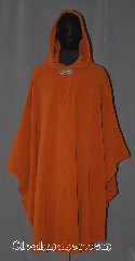 Cloak:3548, Cloak Style:Ruana Shaped Shoulder Cloak, Cloak Color:Burnt Sienna, Fiber / Weave:WindPro Fleece, Cloak Clasp:Triple Medallion, Hood Lining:Unlined matching Shearling interior<br>double sided fabric, Back Length:46&quot; back<br>31&quot; side, Neck Length:21&quot;, Seasons:Winter, Southern Winter, Fall, Spring, Note:A pumpkin spice/ burnt sienna windpro<br>ruana shaped shoulder cloak will<br>keep you warm and dry on chilly nights.<br>This soft and cuddly cloak has a interior<br>faux shearling texture for extra comfort.<br>A cross between a cape and a cloak,<br>a ruana is a great way to keep warm<br>while frequent, unhindered use of<br>your arms is needed.<br>With an overarm of 31&quot; this cloak<br>has less bulk than a<br>traditional Ruana and<br>makes a great driving cloak!<br>The final touch on this functional<br>and elegant cloak is a water resistant outer<br>layer to keep you dry during light rain/snow.<br>Machine washable.