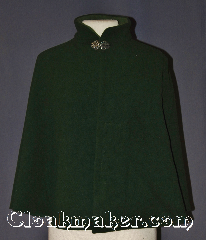 Cloak:3554, Cloak Style:Shape Shoulder Collared with pockets, Cloak Color:Forrest Green, Fiber / Weave:Wool Cashmere Blend, Cloak Clasp:Vale, Hood Lining:Light Green Collar lining<br>hoodless, Back Length:24.25&quot;, Neck Length:18.75&quot;, Seasons:Winter, Southern Winter, Fall, Spring, Note:This sophisticated forest green<br>shape shoulder cloak harkens back to the<br>age of 1950-1960 high fashion.<br>Made of a wool cashmere blend with a<br>lighter green inner collar lining<br>for warmth during bitter winter events.<br>The mandarin collar is secured by a<br>classic pewter vale clasp.<br>Two pockets are hidden on the<br>inside for easy storage of light items <br>Dry clean only..
