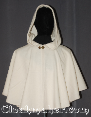 Cloak:3557, Cloak Style:Full Circle Cloak Short, Cloak Color:White / Cream, Fiber / Weave:80% Wool<br>20% Nylon, Cloak Clasp:Unique brass tone leaf heart, Hood Lining:Unlined, Back Length:23&quot;, Neck Length:22&quot;, Seasons:Fall, Spring, Note:&quot;All the land will be mantled with snow.&quot;<br>Roy Bean.<br>This snowy mantle will keep that cool<br>wind off your shoulders for an elegant<br>night out for you or your child.<br>This ivory short cape is ideal for<br>formal fall outdoor events or<br>winter themed indoor galas when you need<br>a little extra warmth.<br>Can be layered on top of other cloaks<br>Spot or dry clean only..