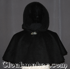 Cloak:3559, Cloak Style:Full Circle Cloak<br>Short Capelet, Cloak Color:Black, Fiber / Weave:Wool Cashmere Blend, Cloak Clasp:Vale, Hood Lining:Unlined, Back Length:17.5&quot;, Neck Length:20.5&quot;, Seasons:Winter, Southern Winter, Fall, Spring, Note:This black cashmere blend mantle<br>will keep winter&#039;s chill off your<br>shoulders for an elegant night out<br>for you or your child.<br>This soft wool short cape<br>is ideal for formal winter outdoor events<br>when you need a little extra warmth.<br>Can be layered on top of other cloaks etc.<br>Spot or dry clean only..