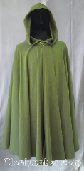 Cloak:3576, Cloak Style:Full Circle Cloak, Cloak Color:sage green herringbone, Fiber / Weave:Polyester Moleskin, Cloak Clasp:Vale, Hood Lining:Unlined, Back Length:42&quot;, Neck Length:22&quot;, Seasons:Spring, Fall, Summer, Note:This sage green full circle cloak has<br>a lightly heathered herringbone print.<br>Ask for a close-up photo of the print<br>and color for a better view.<br>It is lightweight in both flow and feel.<br>Perfect for cool evenings or<br>an accent to that outfit or costume.<br>Accented with a silvertone vale clasp.<br>Best of all machine washable..