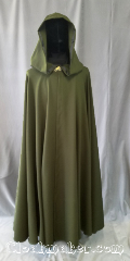 Cloak:3577, Cloak Style:Full Circle Cloak, Cloak Color:Pine Green, Fiber / Weave:Polyester Suiting, Cloak Clasp:Vale, Hood Lining:Unlined, Back Length:54&quot;, Neck Length:23&quot;, Seasons:Spring, Fall, Summer, Note:This dark pine green full circle cloak<br>has a slight stretch to the fabric and<br>is lightweight in both flow and feel.<br>Perfect for cool evenings or an accent<br>to that outfit or costume.<br>Finished with grosgrain ribbon<br>for a professional look.<br>Closure is a silvertone vale clasp.<br>Best of all machine washable..