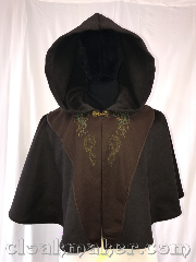 Cloak:3588, Cloak Style:Full Circle Cloak, Cloak Color:Brown, Fiber / Weave:Wool, Cloak Clasp:Special Gold, Hood Lining:Unlined, Back Length:20&quot;, Neck Length:20&quot;, Seasons:Spring, Fall, Southern Winter, Winter, Note:Black with brown tunic panels with<br>green celtic and horses embroidery.<br>Dry clean only..