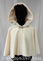 Cloak:3595, Cloak Style:Full Circle Cloak, Cloak Color:Ivory, Fiber / Weave:80% wool,<br> 20% nylon, Cloak Clasp:Vale - Goldtone, Hood Lining:Green gold<br>vine trim, Back Length:18.5&quot;, Neck Length:21&quot;, Seasons:Spring, Fall, Southern Winter.