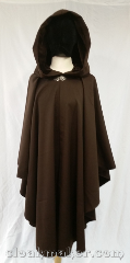 Cloak:3610, Cloak Style:Ruana, Cloak Color:Deep Brown, Fiber / Weave:100% wool gabardine, Cloak Clasp:Vale, Hood Lining:Brown Velvet, Back Length:44&quot;, Neck Length:22&quot;, Seasons:Spring, Fall, Note:Deep brown gabardine wool<br>complimented with a deep brown<br>velvet hood lining.<br>This is a romantic ruana style cloak,<br>shorter on the sides for you to use<br>your sword, or drive to the club.<br>100% wool requires dry cleaning..