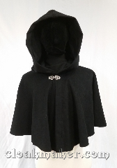Cloak:3616, Cloak Style:Full Circle Cloak, Cloak Color:Black, Fiber / Weave:100% wool, Cloak Clasp:Vale, Hood Lining:Black Moleskin, Back Length:21&quot;, Neck Length:23&quot;, Seasons:Spring, Fall, Southern Winter, Note:A short cloak to cover your arms and<br>chest during the chilly days of<br>spring or late fall.<br>The darkest black basket weave fabric<br>is complimented by a black moleskin<br>hood lining, very dramatic.<br>Dry clean only..