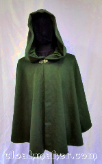 Cloak:3618, Cloak Style:Ruana Shape Shoulder Cloak, Cloak Color:Loden Green, Fiber / Weave:100% Wool, Cloak Clasp:Vale, Hood Lining:Green Moleskin, Back Length:27&quot;, Neck Length:22&quot;, Seasons:Spring, Fall, Southern Winter, Note:A handsome car cloak for days of<br>autumn or spring when you need a bit<br>more than a sweater.<br>San Francisco summer?<br>Oh this would be great for that!<br> Beautiful loden green with a<br>tiny hint of heathered blue.<br>The hood lining of matching<br>green moleskin also lines the front<br>of the inner cloak for a very finished look.<br>Dry clean only..