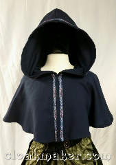 Cloak:3633, Cloak Style:Full Circle Cloak, Cloak Color:Light Navy Blue, Fiber / Weave:Wool Suiting, Cloak Clasp:Snaps, Hood Lining:Unlined, Back Length:16&quot;, Neck Length:22&quot;, Seasons:Spring, Summer, Fall, Note:This short full circle cloak is a<br>light navy blue color<br>and secures with snaps.<br>It is paired with the &#039;Florentine, Narrow<br>in Silver, blue, & red&#039; trim.<br>Dry clean only.