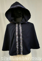 Cloak:3635, Cloak Style:Full Circle Cloak, Cloak Color:Navy Blue, Fiber / Weave:Wool Suiting, Cloak Clasp:Snaps, Hood Lining:Unlined, Back Length:21&quot;, Neck Length:18&quot;, Seasons:Summer, Spring, Fall, Note:This short full circle cloak is a light<br>navy blue color and secures with<br>a hook and eye.<br>It is paired with the<br>&#039;Stylized Swirl in Gold & Blue&#039; trim.<br>Dry clean only..