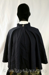 Cloak:3649, Cloak Style:Full Circle Cloak, Cloak Color:Dark Navy Blue, Fiber / Weave:100% wool, Cloak Clasp:Button, Hood Lining:N/A, Back Length:21&quot;, Neck Length:20&quot;, Seasons:Spring, Summer, Fall, Note:A sweet little navy blue cloak<br>without a hood, has a pretty<br>silvertone triscal button.<br>100% wool, dry clean only..