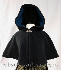 Cloak:3651, Cloak Style:Shaped Shoulder Cloak, Cloak Color:Black, Fiber / Weave:Windblock Fleece, Cloak Clasp:Vale, Hood Lining:teal self lined, Back Length:17&quot;, Neck Length:20&quot;, Seasons:Southern Winter, Spring, Fall, Note:This shaped shoulder cloak is black<br>and has a teal blue lining.<br>Wind blocking fleece material,<br>machine wash cold using mild<br>detergent and tumble dry on low..