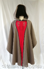 Cloak:3652, Cloak Style:Cape / Ruana, Cloak Color:Taupe, Fiber / Weave:Wool, Cloak Clasp:Snaps, Hood Lining:unlined, Back Length:42&quot;, Neck Length:26&quot;, Seasons:Southern Winter, Spring, Fall, Note:A taupe colored ruana style cloak,<br>this piece has decorative<br>hippocampus and dragon embroidery<br>and a complimentary applique<br>of red and black edging.<br>Closes with snaps, this cloak<br>is a true neutral taupe color<br>that is grey in some lights and<br>a tad brown in others.<br>Hand wash or machine wash<br>gentle in cold water, line dry, can be<br>machine dried on low temperature..