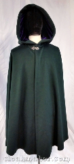 Cloak:3674, Cloak Style:Shaped Shoulder Cloak, Cloak Color:Forest green, Fiber / Weave:80% wool, 20% nylon, Cloak Clasp:Vale, Hood Lining:Purple velvet, Back Length:40&quot;, Neck Length:21&quot;, Seasons:Southern Winter, Spring, Fall, Note:Walk through the greenery in this<br>forest green shaped shoulder cloak<br>with a purple velvet hood lining.<br>A silvertone vale clasp keeps in<br>the warmth on Autumn evenings.<br>Dry clean only..