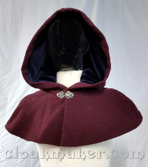 Cloak:3687, Cloak Style:Shaped Shoulder Cloak, Cloak Color:Heathered Wine Red, Fiber / Weave:80% wool, 20% nylon, Cloak Clasp:Vale, Hood Lining:Navy velvet, Back Length:10&quot;, Neck Length:23&quot;, Seasons:Winter, Southern Winter, Fall, Spring, Note:Heathered wine colored shaped shoulder<br>cloak with a navy velvet hood lining.<br>Features a silvertone vale clasp closure.<br>Wool blend, dry clean only..