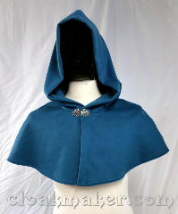 Cloak:3690, Cloak Style:Shaped Shoulder Cloak, Cloak Color:Soft Teal Blue, Fiber / Weave:80% wool, 20% nylon, Cloak Clasp:Vale, Hood Lining:Unlined, Back Length:12&quot;, Neck Length:23&quot;, Seasons:Winter, Southern Winter, Spring, Fall, Note:A soft teal blue colored shaped shoulder<br>capelet with a silvertone vale clasp.<br>Made from a very pleasant<br>feeling wool, dry clean only..