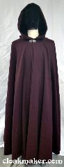 Cloak:3698, Cloak Style:Full Circle Cloak, Cloak Color:Burgundy Wine, Fiber / Weave:100% wool, Cloak Clasp:Vale, Hood Lining:Black silk Velvet, Back Length:55&quot;, Neck Length:21&quot;, Seasons:Spring, Fall, Southern Winter, Note:A burgundy wine colored<br>full circle cloak with a<br>silvertone vale clasp and a<br>black silk velvet hood lining.<br>100% wool, dry clean only..