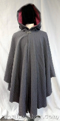 Cloak:3705, Cloak Style:Cape / Ruana, Cloak Color:Slate or dove grey, Fiber / Weave:100% wool, Cloak Clasp:Vale, Hood Lining:Rose pink moleskin, Back Length:46.5&quot;, Neck Length:24&quot;, Seasons:Spring, Fall, Note:This ruana style cloak with its rose pink<br>moleskin hood lining and silvertone<br>vale clasp is the perfect addition<br>for the chilly spring mornings.<br>Has a pretty pattern in a 100% wool fabric,<br>dry clean only.<br>This cloak is half off original price,<br>there is a spot on the shoulder that<br>was sprayed with FrayCheck<br>and it has left discoloration..
