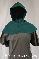 Cloak:H118, Cloak Style:Regular Hood, Cloak Color:Sea Green, Fiber / Weave:Wool blend suiting, Hood Lining:Unlined, Back Length:9&quot;, Neck Length:M - neck 24&quot;, Seasons:Spring, Fall, Note:This hood is a beautiful sea green color.<br>Wool blend suiting, has been<br>treated so that it&#039;s a little shinier<br>and softer than regular wool.<br>Dry clean only.<br>24&quot; neck hole.<br>Pictured on tunic J526<br>Tunic not included..