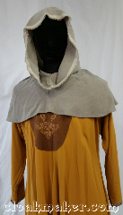Cloak:H121, Cloak Style:Oversized Hood, Cloak Color:Grey/tan, rough edges, Fiber / Weave:Wool, Hood Lining:Unlined, Back Length:8&quot;, Neck Length:L - neck 26&#039;, Seasons:Spring, Fall, Note:Perfect for going out to the desert.<br>Wear this to Burning Man<br>or to a post-apocalypse LARP.<br>This hood is a grey/tan color<br>with unfinished edges<br>around the Oversized face hole.<br>100% wool. Dry clean or carefully<br>handwash and let drip dry.<br>26&quot; neck hole.<br>Pictured on tunic J529<br>Tunic not included..