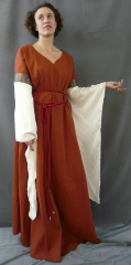"Gown ID:G486, Gown Color:Sienna, Style:12th Century, Sleeve:Long Drop sleeve in cream, Trim:Red on Black Stained Glass Floral at bicep, Neckline Type:V-Neck, Fabric:Cotton Lycra, Sleeve Length:31"", Back Length:58""."