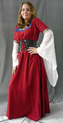 "Gown ID:G524, Gown Color:Colonial Red, Style:12th Century, Sleeve:Short Sleeve, Trim:Crusader shield at bicep, Neckline Type:Square with bright blue contrast fabric border, Fabric:Linen Rayon, Sleeve Length:18"", Back Length:54""."