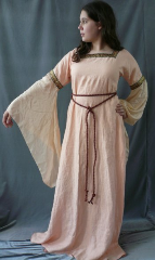 "Gown ID:G533, Gown Color:Peach, Style:12th Century, Sleeve:Long Drop sleeve in peach silk Habutai, Trim:Paisley Dancing on the Mountain at bicep, Neckline Type:Square, Fabric:Linen, Sleeve Length:31, Back Length:58.5""."
