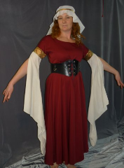 "Gown ID:G604, Gown Color:Maroon, Style:12th Century, Sleeve:Long split drop sleeve wth in natural cotton muslin with bullseye trim, Trim:Bullseye, Neckline Type:Ballet, Fabric:Rayon Polyester, Sleeve Length:28.5"", Back Length:49""."