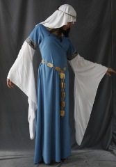"Gown ID:G614, Gown Color:French Blue, Style:12th Century, Sleeve:Long drop sleeve of white rayon challis, Trim:Tapestry Hunt trim at bicep, Neckline Type:Scoop, Fabric:Polyester Moleskin, Sleeve Length:32"", Back Length:55.5""."