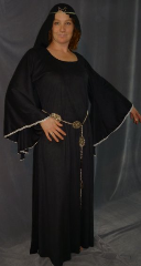 "Gown ID:G621, Gown Color:Black, Style:12th Century, Sleeve:Long drop sleeve, Trim:silver lace trim at edge, Neckline Type:Ballet, Fabric:sueded polyester moleskin, Sleeve Length:31"", Back Length:58""."