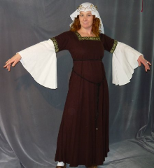 "Gown ID:G625, Gown Color:Brown, Style:12th Century, Sleeve:Long drop sleeve of white rayon challis with Cross trim at bicep, Trim:Cross trim at bicep and neck, Neckline Type:Square, Fabric:Linen / Rayon, Sleeve Length:30"", Back Length:55""."