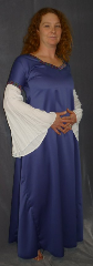 "Gown ID:G626, Gown Color:Blue, Style:12th Century, Sleeve:Long drop sleeve of white rayon challis with Medallion trim at bicep, Trim:Medallion trim at bicep and neck, Neckline Type:Square sweetheart, Fabric:Linen / Cotton, Sleeve Length:35"", Back Length:58""."