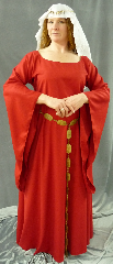 "Gown ID:G638, Gown Color:Red, Style:12th Century, Sleeve:Long drop sleeve, Trim:Celtic beasties Red/Gold/Silver, Neckline Type:Ballet, Fabric:Rayon Polyester, Sleeve Length:30"", Back Length:56""."