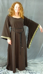 "Gown ID:G653, Gown Color:Brown, Style:12th Century, Sleeve:Long drop sleeve, Trim:Cross trim at sleeve edge, Neckline Type:Ballet, Fabric:Washed Worsted Wool Crepe, Sleeve Length:28.5"", Back Length:56.5""."