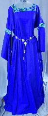 "Gown ID:G665, Gown Color:Blue, Style:12th Century, Sleeve:Long Drop Sleeve with Green/Blue Celtic Beasties trim at bicep and neckline, Trim:Green/Blue Celtic Beasties trim at bicep and neckline, Neckline Type:Square, Fabric:Linen/cotton, Sleeve Length:30"", Back Length:60""."
