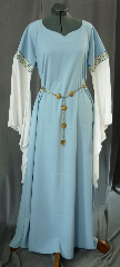 "Gown ID:G668, Gown Color:Powder Blue, Style:12th Century, Sleeve:Long drop sleeve of white rayon challis with Elizabethan Floral Gold/blue trim at bicep, Trim:Elizabethan Floral Gold/blue trim at bicep, Neckline Type:Sweetheart V, Fabric:Polyester Moleskin, Sleeve Length:30"", Back Length:57""."