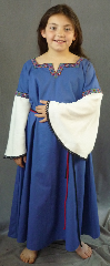 "Gown ID:G678, Gown Color:Blue, Style:12th Century, Sleeve:Long Drop Sleeve in cream cotton with Fantasia (Purple/Teal) at bicep and small black lace at end, Trim:Fantasia, Purple/Teal at neck and bicep, Neckline Type:Squared Keyhole with  Purple/Teal Fantasia trim, Fabric:Cotton with Rayon Sleeves, Sleeve Length:25"", Back Length:43""."