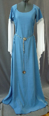 "Gown ID:G686, Gown Color:Cornflower Blue, Style:12th Century, Sleeve:Long drop sleeve of white rayon challis with Floral Scroll Blue/White trim at bicep, Trim:Floral Scroll Blue/White trim at bicep, Neckline Type:Scoop, Fabric:Polyester Moleskin, Sleeve Length:32"", Back Length:63""."