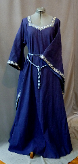 Gown ID:G687, Gown Color:Bright Navy Blue, Style:12th Century, Sleeve:Long Drop Sleeve<br>with 2-Tone Blue Floral trim at sleeve edge, Trim:2-Tone Blue Floral trim at neck<br>and sleeve edge, Neckline Type:Squared Sweetheart with<br>2-Tone Blue Floral trim, Fabric:Linen, Sleeve Length:25.5&quot;, Back Length:56&quot;.