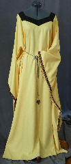 "Gown ID:G695, Gown Color:Yellow, Style:12th Century, Sleeve:Long drop sleeve with Sunflower trim on edge, Trim:Sunflower trim on sleeve edge, Neckline Type:Squared sweetheart with black contrasting border, Fabric:Corded Polyester, Sleeve Length:32"", Back Length:61""."