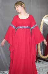 "Gown ID:G703, Gown Color:Red - comes with matching removeable, adjustable  trim belt, Style:12th Century, Sleeve:Long Drop Sleeve with Florentine Wide (silver blue & red) trim at bicep, Trim:Florentine Wide (silver blue & red) at bicep, and on belt (included), Neckline Type:Ballet, Fabric:Washed Linen, Sleeve Length:30"", Back Length:58""."