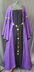 "Gown ID:G708, Gown Color:Purple with a black front panel, Style:12th Century, Sleeve:Long Drop Sleeves with Medallian wide trim at biceps and narrow black lace at wrist, Trim:Medallian wide trim at biceps and narrow black lace at wrist, Neckline Type:Square trimmed in Medallion wide trim, Fabric:Linen, Sleeve Length:32"", Back Length:61""."